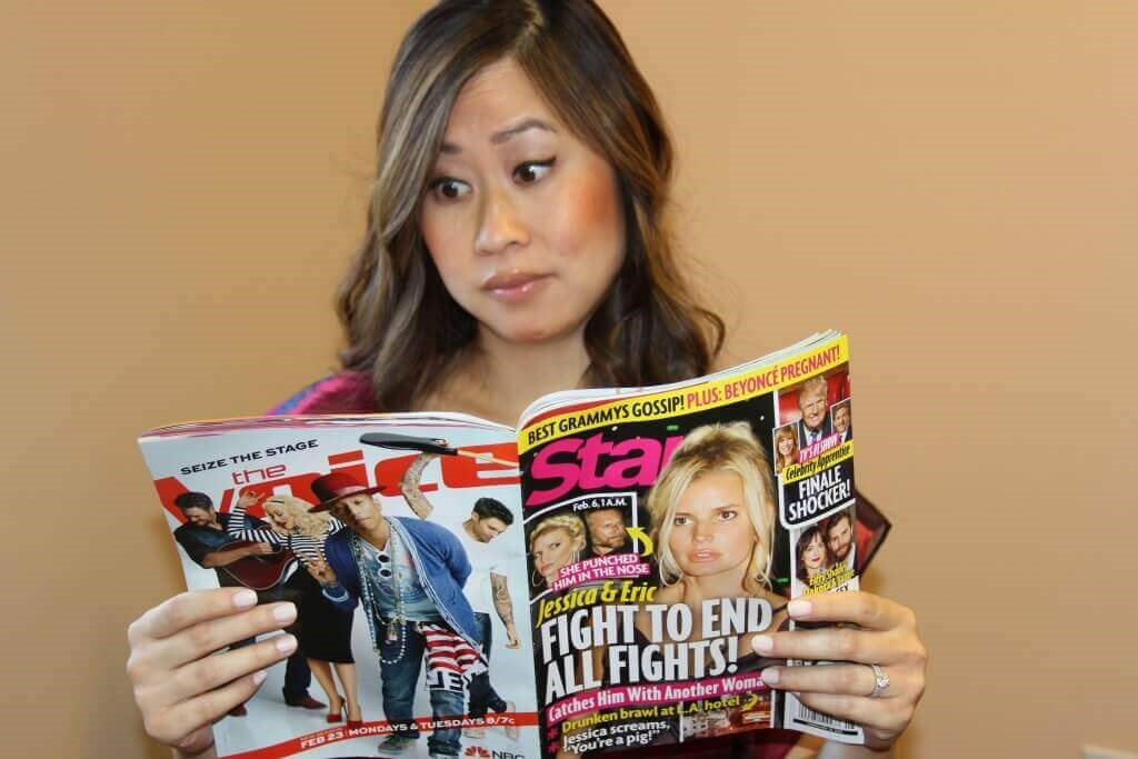 Woman reading tabloid magazine about celebrity plastic surgery