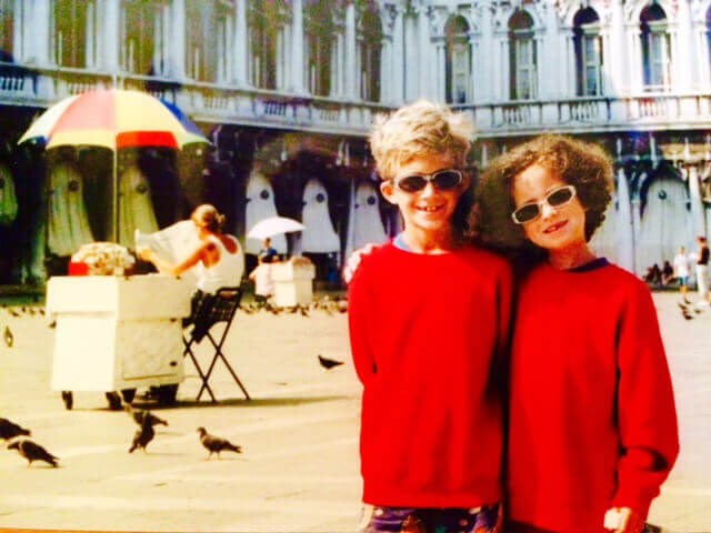 Diego and Siena Canales as children wearing sunscreen, sunglasses, and long sleeved in Venice