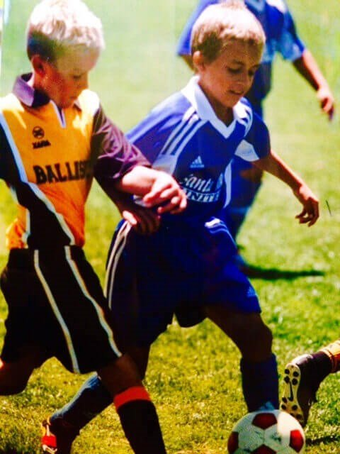 Diego Canales as a Boy Running with the Ball in a Soccer Game