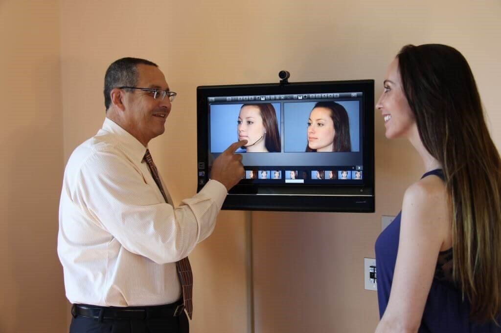 Dr. Francisco Canales discussing a plastic surgery patient's goals and options.