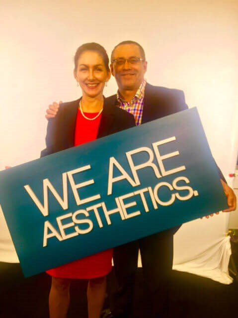 Heather Furnas, MD and Francisco Canales, MD holding sign with ASAPS slogan,