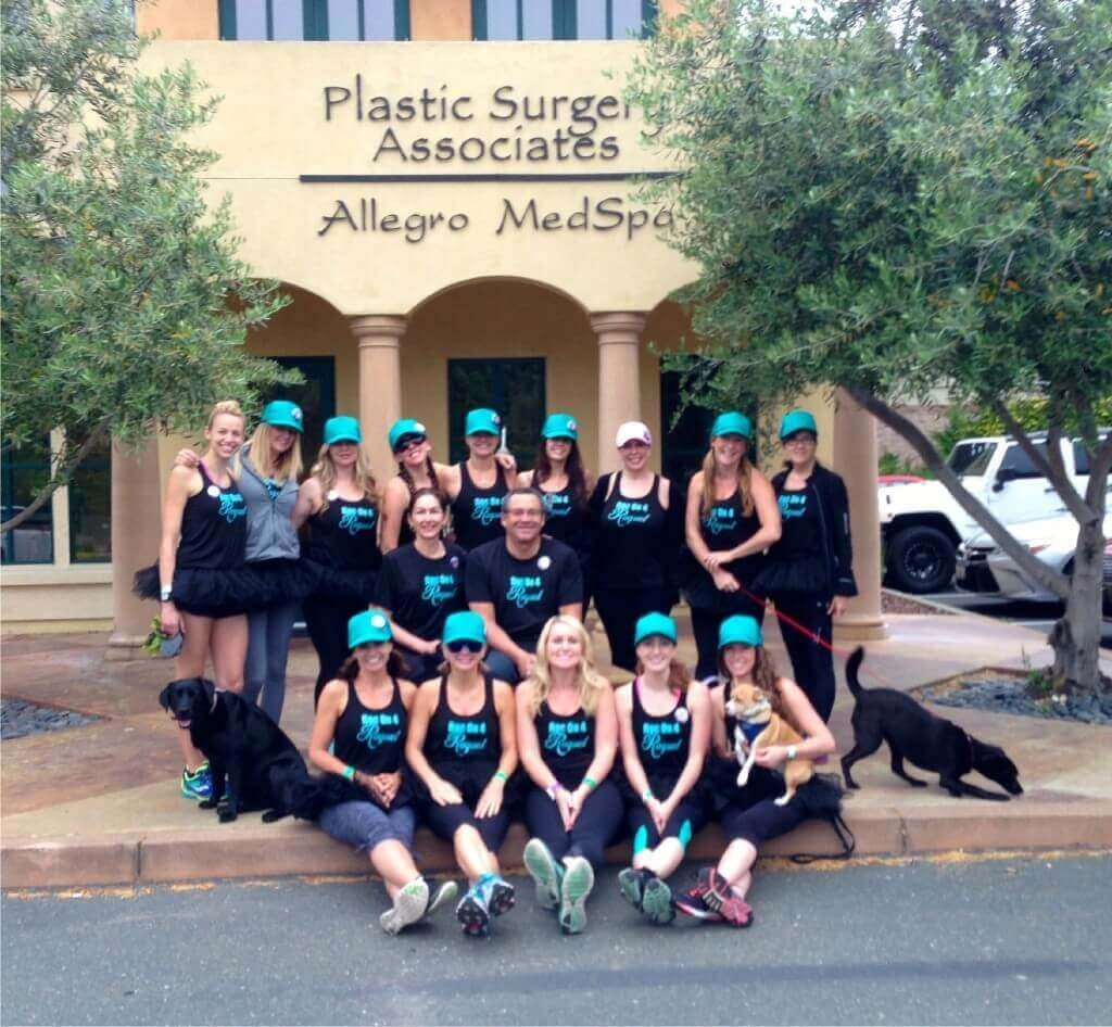 Plastic Surgery Associates suited up to run in black with tutus and teal caps. #RocOn4Raquel