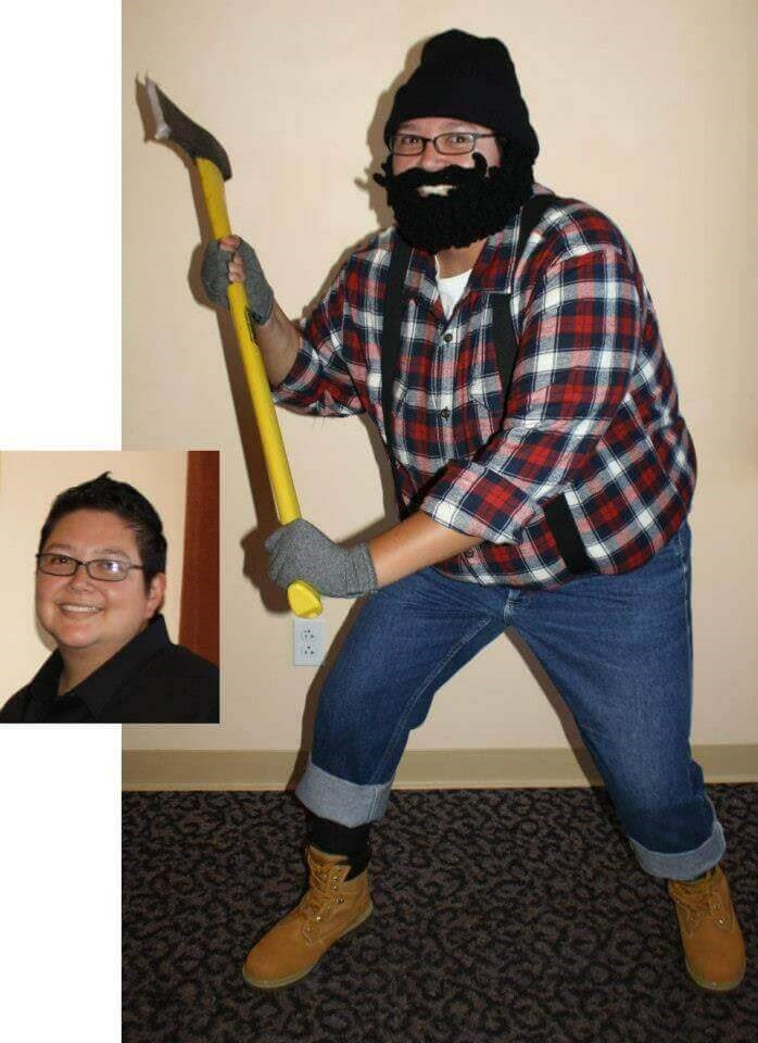 Raquel the Lumberjack with her crocheted beard, axe, and flannel shirt