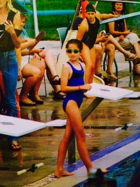 Siena Canales as a Child Wearing Sunscreen and Tinted Goggles at a Swim Meet