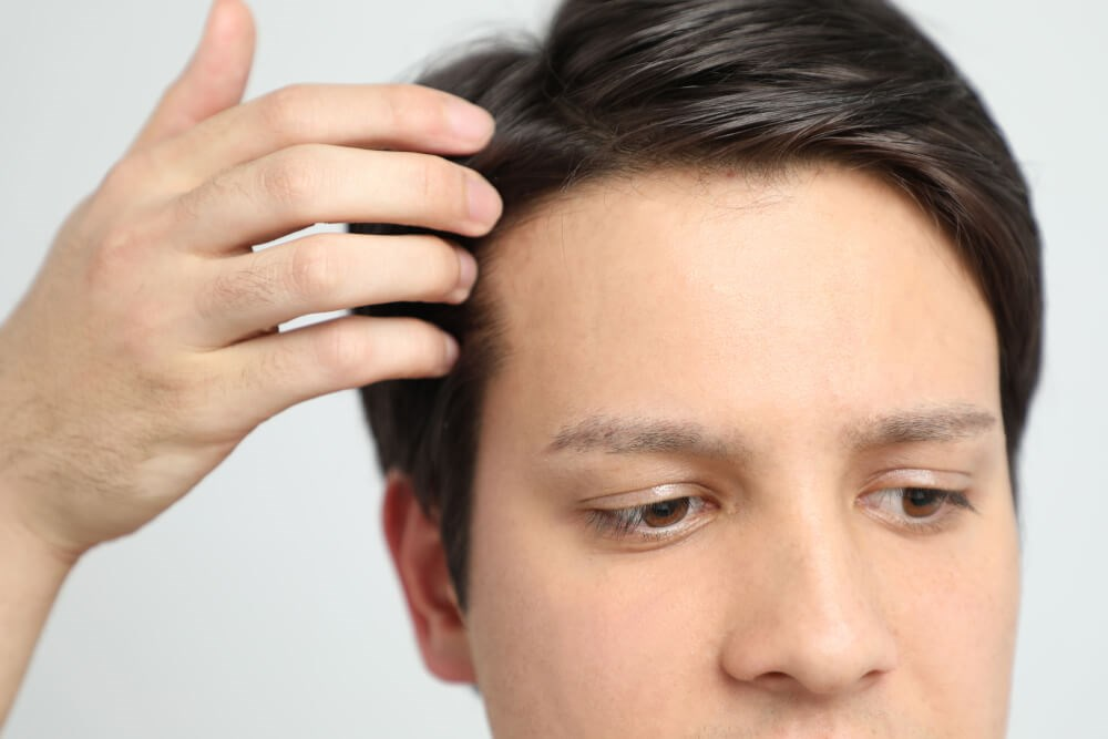 Man Touching Hair Photo
