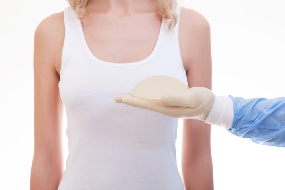 Doctor Holding Implant Photo
